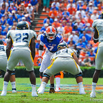 LB Ronald Powell lines up for the play.  Gators vs Toledo.  8-31-13.