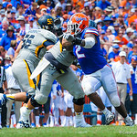 DL Dominique Easley tries to shed the block.  Gators vs Toledo.  8-31-13.