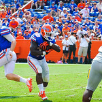 QB Jeff Driskel hands the ball off to  RB Mack Brown who rushed downfield.  Gators vs Toledo.  8-31-13.
