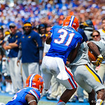 DB Cody Riggs makes the tackle.  Gators vs Toledo.  8-31-13.
