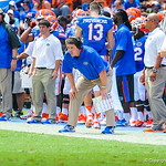 Coach Muschamp watches the defense.  Gators vs Toledo.  8-31-13.