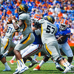The gator defense try to shed the blocks.  Gators vs Toledo.  8-31-13.