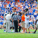 The captons meet at midfield for the coin toss.  Gators vs Toledo.  8-31-13.