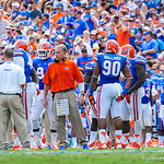 The gator coaches talk with the defense during a timeout.  Gators vs Toledo.  8-31-13.
