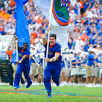 A gator cheerleader runs out with the gator flag as the gators take the field.  Gators vs Toledo.  8-31-13.