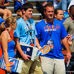 Gator football recruits watch on from the sideline.  Gators vs Toledo.  8-31-13.