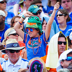 An enthusastic gator fan cheers on her favorite team.  Gators vs Toledo.  8-31-13.