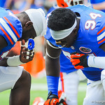 DL Bryon Cox Jr and a fellow gator kneel for a prayer before the game.  Gators vs Toledo.  8-31-13.