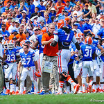 Coach Pease congratulates Ronald Powell as he exits the field.  Gators vs Toledo.  8-31-13.
