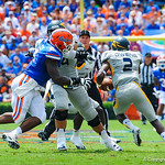 DL Dominique Easley rushes toward the Toledo QB.  Gators vs Toledo.  8-31-13.