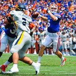 QB Jeff Driskel throws the ball downfield.  Gators vs Toledo.  8-31-13.