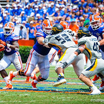 RB Mack Brown takes the handoff and bounces around the outside.  Gators vs Toledo.  8-31-13.