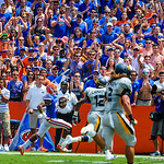DB Valdez Showers rushes around the corner after receiving the punt.  Gators vs Toledo.  8-31-13.