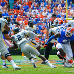 DL Donte Fowler Jr sheds a blocker to tackle the Toledo QB.  Gators vs Toledo.  8-31-13.