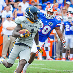 LB Jeremi Powell runs after Toledo's Wr Reedy.  Gators vs Toledo.  8-31-13.