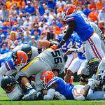 The gator defense converge on the ball carrier.  Gators vs Toledo.  8-31-13.