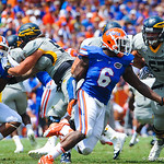 DL Donte Fowler Jr. rushes around the outside.  Gators vs Toledo.  8-31-13.