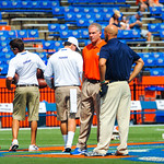 Coach Pease watches his players as they warm up.  Gators vs Toledo.  8-31-13.
