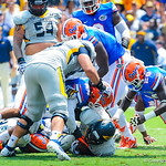 The gator defense swarms the ball.  Gators vs Toledo.  8-31-13.