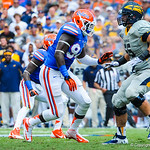 DL Bryon Cox Jr. tries to elude the Toledo offensive lineman.  Gators vs Toledo.  8-31-13.