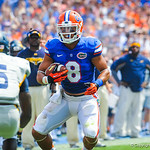 WR Trey Burton catches the ball and tries to elude the Toledo DB.  Gators vs Toledo.  8-31-13.