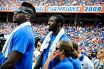 Florida gator basketball stars Patrick and Will Legete watch the game from the sideline.  Gators vs Tennessee Volunteers.  September 21, 2013.