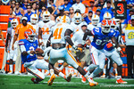 QB Tyler Murphy slides for a gator first down after escaping the pocket and nearly being sacked.  Gators vs Tennessee Volunteers.  September 21, 2013.
