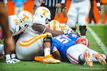 Gator LB Michael Taylor dives on the lose ball to recover the fumble.  Gators vs Tennessee Volunteers.  September 21, 2013.