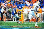 Gator QB Tyler Murphy scrambles around the right side as he escapes the pocket and takes off running downfield.   Gators vs Tennessee Volunteers.  September 21, 2013.