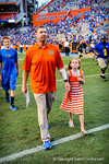 Coach Brent Pease walks hand in hand with his daughter after a great gator win.  Gators vs Tennessee Volunteers.  September 21, 2013.