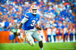 QB Tyler Murphy bootlegs and scrambles around the right side.  Gators vs Tennessee Volunteers.  September 21, 2013.