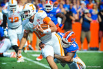 Gator LB Antonio Morrison tackles Tennessee Qb Nathan Peterman.   Gators vs Tennessee Volunteers.  September 21, 2013.