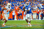 QB Tyler Murphy scrambles out of the pocket and looks for downfield for an open WR Solomon Patton.  Gators vs Tennessee Volunteers.  September 21, 2013.
