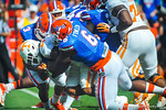 DL Dante Fowler and the gator defense tackle Tennessee RB Raijon Neal.  Gators vs Tennessee Volunteers.  September 21, 2013.