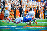 LB Antonio Morrison makes the diving tacke.  Gators vs Tennessee Volunteers.  September 21, 2013.
