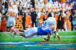 LB Antonio Morrison makes the diving tacke.  Gators vs Tennessee Volunteers.  September 21, 2013.