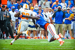 DL Dante Fowler dives to try to make the tackle on Tennessee RB Raijon Neal.  Gators vs Tennessee Volunteers.  September 21, 2013.