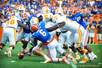 Gator DL Dante Fowler dives and tackles Tennessee QB Nathan Peterman and causes the fumble.  Gators vs Tennessee Volunteers.  September 21, 2013.