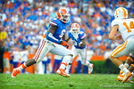 DL Dante Fowler trying to find a way to the Tennessee quarterback.   Gators vs Tennessee Volunteers.  September 21, 2013.