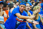 A gator fan doing the gator chomp.  Gators vs Tennessee Volunteers.  September 21, 2013.