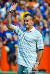 Florida Gator head basketball coach Billy Donovan waves to the crowd as his team is honored during the Tennessee game.  Gators vs Tennessee Volunteers.  September 21, 2013.