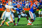 QB Tyler Murphy scrambles to get away from the Tennessee defense as the pocket collapses and he is nearly tackled.  Gators vs Tennessee Volunteers.  September 21, 2013.