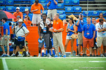 Defensive Coordinator D.J. Durkin talks with a recruit visiting for the Tennessee game.  Gators vs Tennessee Volunteers.  September 21, 2013.