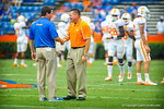 Florida Gator head coach Will Muschamp and Tennessee Volunteer head coach Butch Jones shake hands prior to the start of the game.  Gators vs Tennessee Volunteers.  September 21, 2013.