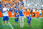 The florida gator gymnastics team gator chomps and waves to the crowd as they are honored during the football game.  Gators vs Tennessee Volunteers.  September 21, 2013.