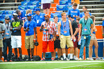 Recruits stand sideline and watch the Gators warm up for the game against Tennessee.  Gators vs Tennessee Volunteers.  September 21, 2013.