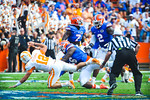 DL Dante Fowler gets a hit in on Tennessee QB Nathan Peterman.  Gators vs Tennessee Volunteers.  September 21, 2013.
