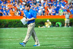 Coach Will Muschamp walks off the field after checking on OL Jon Halapio.   Gators vs Tennessee Volunteers.  September 21, 2013.