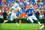 RB Matt Jones sprints around the outside but unfortunately loses grip on the ball causing a gator turnover.  Gators vs Tennessee Volunteers.  September 21, 2013.