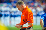 Florida defensive coordinator D.J. durkin looks at his charts to plan out his strategy for the Tennessee game. Gators vs Tennessee Volunteers.  September 21, 2013.